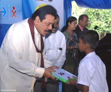 Sri Lankan President handing out laptops on December 10.