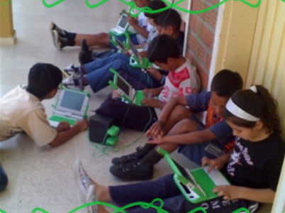 Children relaxing outside of class at the Marina Orth school