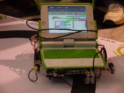 XO on top of a flat wheeled robot, showing the TurtleArt program controlling it